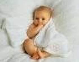Як правильно укладати однорічної дитини спати? фото