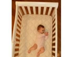 Купити матрац в ліжечко для дитини фото