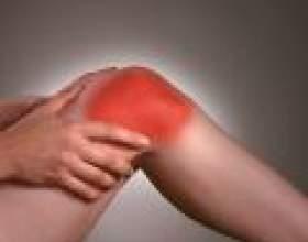Чому болять коліна фото