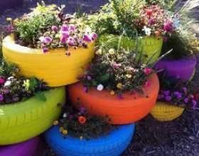 Садовий дизайн: клумби з покришок своїми руками фото